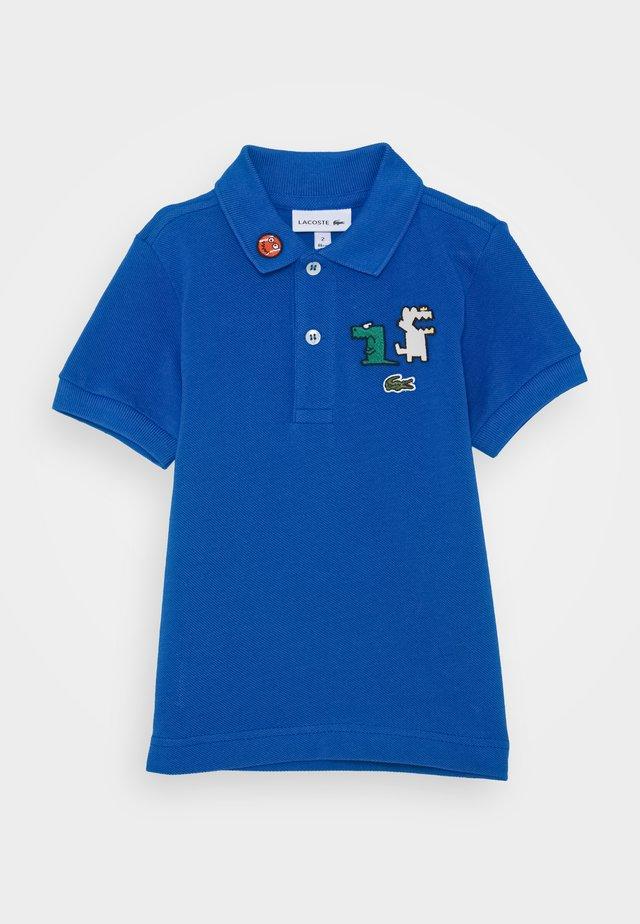 BABY PETIT - Polo shirt - utramarine