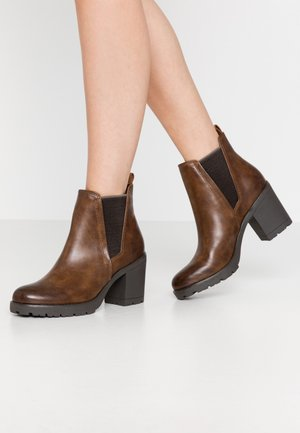 Ankle boots - cognac antic