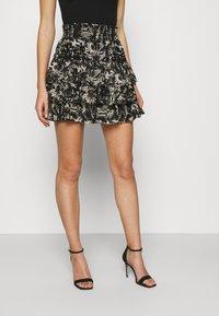 NIKKIE - RUFFLE SKIRT - Mini skirt - black - 0