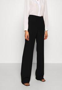 Emporio Armani - TROUSER - Trousers - black - 0