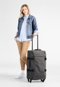 Eastpak - TRANS4 M CORE COLORS  - Wheeled suitcase - black denim - 0
