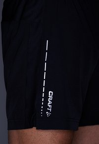 Craft - ESSENTIAL 2-IN-1 SHORTS - Sports shorts - black - 4