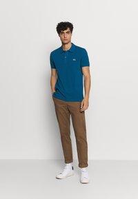 Lacoste - Polo shirt - raffia matting - 1