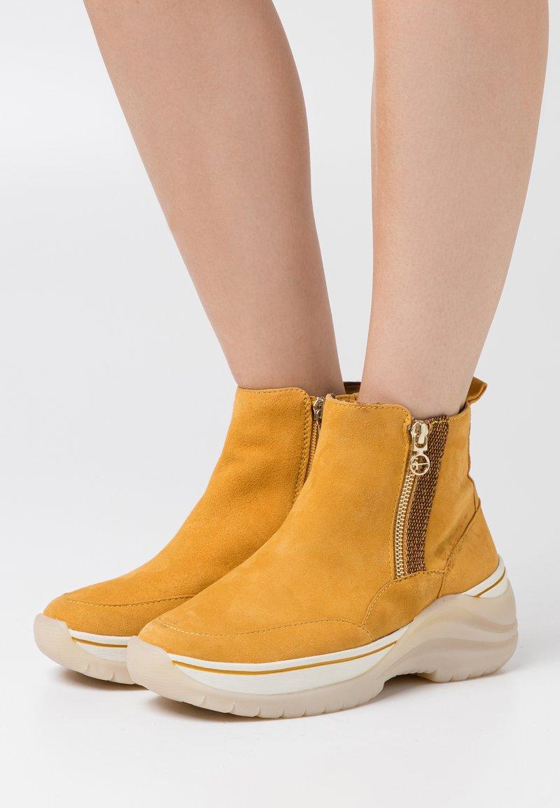 Tamaris Pure Relax - Ankle boots - saffron