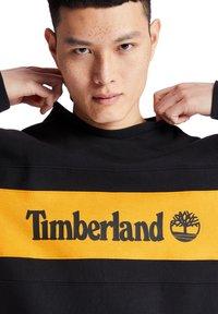 Timberland - CUT AND SEW CREW - Bluza - black-dark cheddar - 4