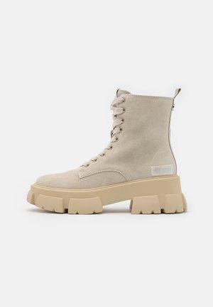 TANKER - Platform ankle boots - beige