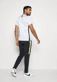 Nike Performance - ACADEMY PANT WINTERIZED - Träningsbyxor - black/volt - 2