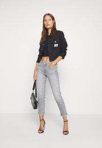Calvin Klein Jeans - CROP TRUCKER - Denim jacket - washed black - 1