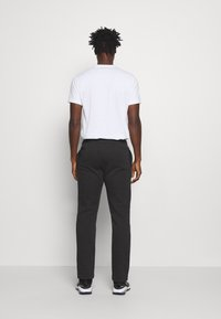 Champion - LEGACY STRAIGHT HEM PANTS - Joggebukse - black
