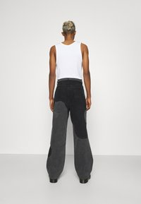 Jaded London - YIN AND YANG CUT AND SEW - Jeans relaxed fit - black - 2