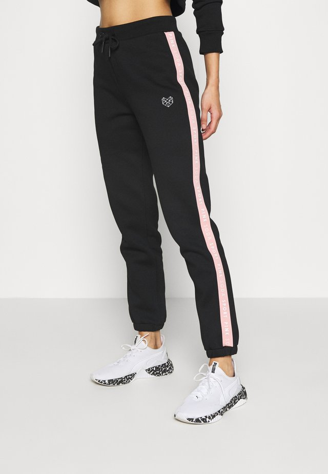 FULLER TAPE - Tracksuit bottoms - black/pink