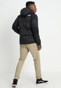 The North Face - HIMALAYAN LIGHT HOODIE - Down jacket - black - 2