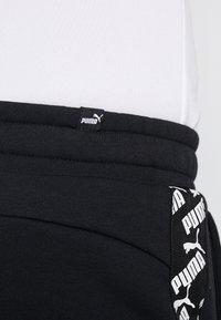 Puma - AMPLIFIED PANTS - Tracksuit bottoms - black - 5