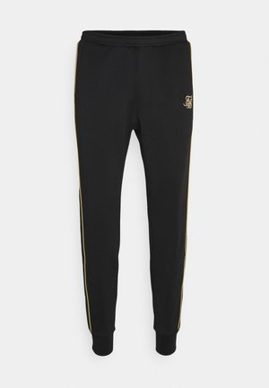 ASTRO CUFFED TRACK PANTS - Jogginghose - black/gold