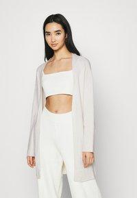 NA-KD - NA-KD X ZALANDO EXCLUSIVE - SOFT RIBBED CARDIGAN - Cardigan - off-white - 0