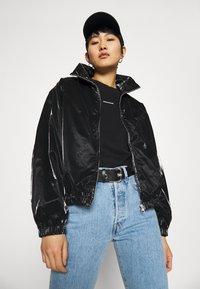Calvin Klein Jeans - ZIP THROUGH - Windbreaker - black - 4