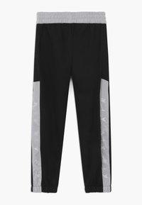 Nike Sportswear - Tracksuit bottoms - black/white - 1
