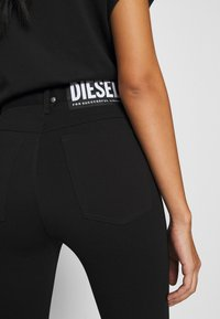 Diesel - P-CUPERY TROUSERS - Trousers - black - 7