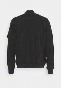 C.P. Company - OUTERWEAR SHORT JACKET - Summer jacket - black - 6
