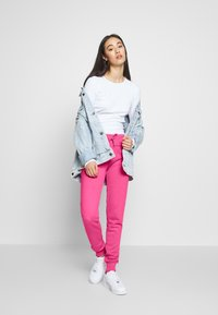 Superdry - Tracksuit bottoms - fluro pink - 1