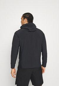 Nike Performance - Camiseta de deporte - black/white - 2