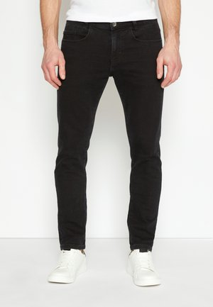 TROY - Slim fit jeans - black denim