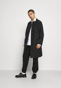 KARL LAGERFELD - UNISEX - Waterproof jacket - black - 1