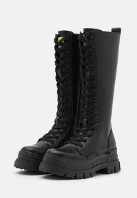 Buffalo - VEGAN ASPHA ON - Platform boots - black - 2