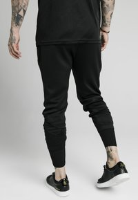 SIKSILK - SIKSILK TRANQUIL DUAL CUFF PANT - Pantaloni sportivi - black - 2
