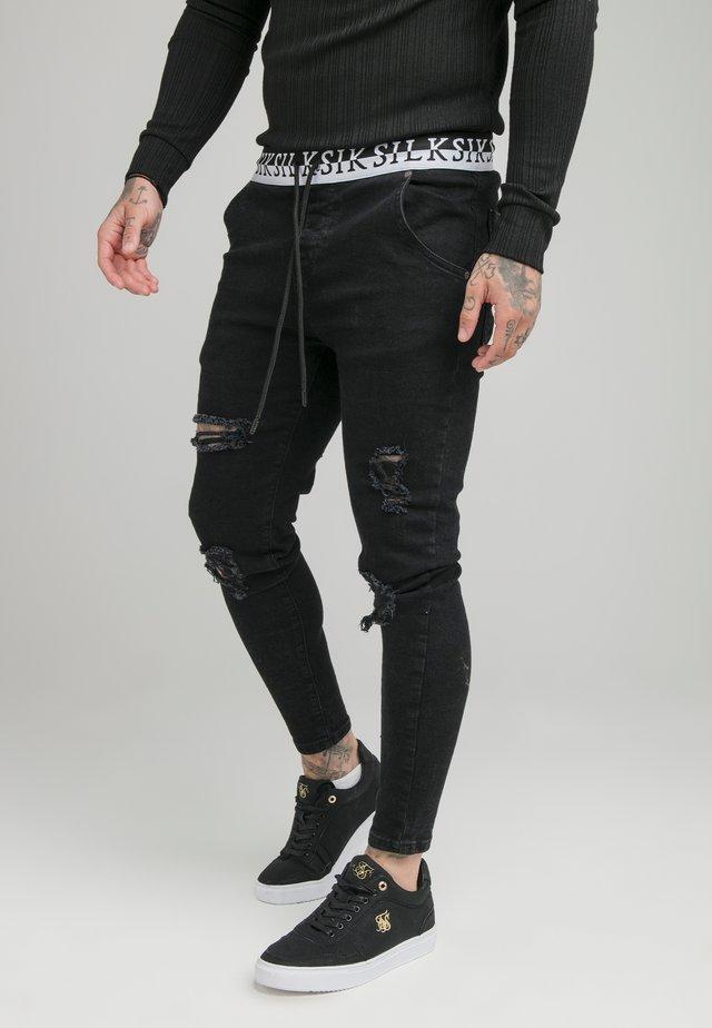 DISTRESSED ELASTICATED - Jeans slim fit - washed black