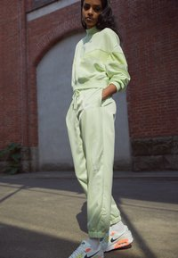 Nike Sportswear - Tracksuit bottoms - lime ice/white - 1