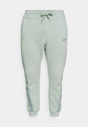 ASTRA WRAP SW PANT - Tracksuit bottoms - blue