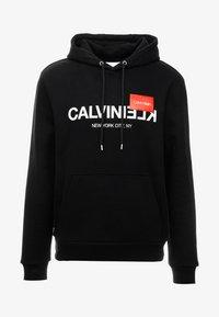 Calvin Klein - TEXT LOGO HOODIE - Hoodie - black - 4
