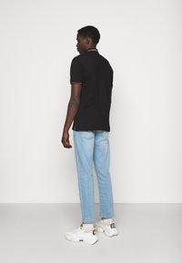 Versace Jeans Couture - PLAIN  - Polo shirt - black/gold - 2