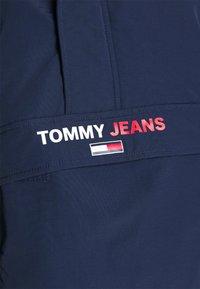Tommy Jeans - SOLID POPOVER JACKET UNISEX - Windbreaker - twilight navy - 6