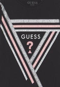 Guess - JUNIOR - Print T-shirt - black - 2