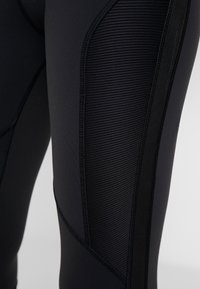 Reebok - TRAINING HIGH-RISE LEGGING - Tights - black