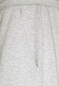 Urban Threads - RELAXED JOGGER UNISEX - Tracksuit bottoms - light grey marl - 2