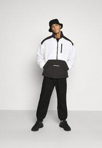 Mennace - HALF ZIP PANELLED - Summer jacket - white - 1