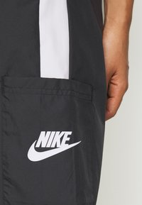 Nike Sportswear - PANT  - Tracksuit bottoms - black/white - 4