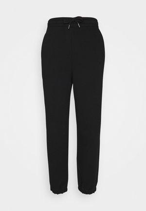 RUBI PANTS - Tracksuit bottoms - black