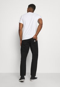 Carhartt WIP - NEWEL PANT MAITLAND - Jeans relaxed fit - black rinsed - 2