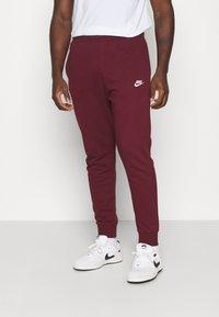 Nike Sportswear - CLUB - Tracksuit bottoms - dark beetroot/white - 0