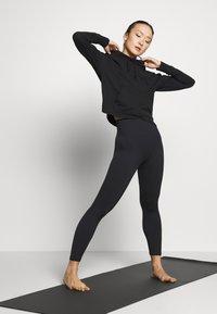 Nike Performance - YOGA HOODIE - Long sleeved top - black/dark smoke grey - 1