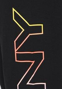 DKNY - OMBRE LOGO CROPPED  - Tracksuit bottoms - black - 2