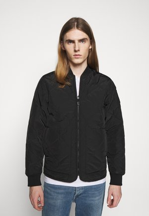STENCIL - Light jacket - black/orange