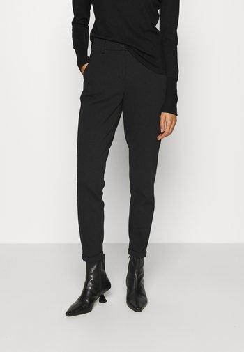 MELINA - Trousers - black