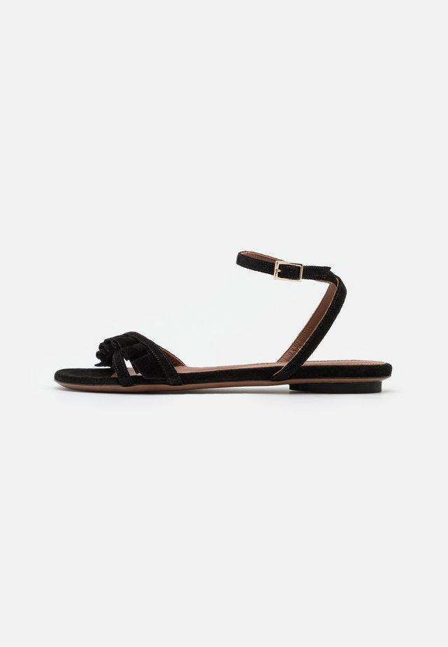 FLAT - Sandaalit nilkkaremmillä - black