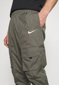 Nike Sportswear - AIR PANT  - Tracksuit bottoms - twilight marsh - 3