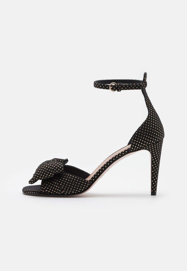 High heeled sandals - nero/oro